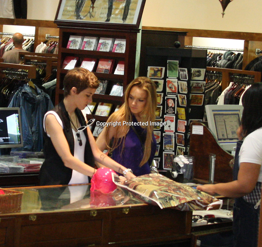 "9-25-08..Lindsay Lohan shopping at a store called ""American Rag"" with Samantha Ronson in Los Angeles ca. Samantha picked up a pink skull & was joking with Lindsay about it.  When leaving Lindsay and Samantha both got into her Porsche then Lindsay kissed  Samantha goodbye real quick & got out of the Porsche. Nobody got a picture. Then Lindsay jumped in another friends car and gave her a ride back to her hotel.  ..AbilityFilms@yahoo.com.805-427-3519.www.AbilityFilms.com"