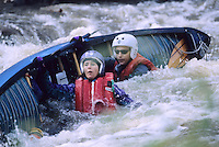 Overturned canoe and people in rapids, Delaware Water Gap, New Jersey