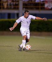 Danny Cruz dribbles the ball. US Under 20 Men's National Team played to a scoreless draw vs Trinidad & Tobago, advancing after winning 4-3 on penalty kicks at the Marvin Lee Stadium in Macoya, Trinidad on March 13th, 2009 during the 2009 CONCACAF U-20 Championship.