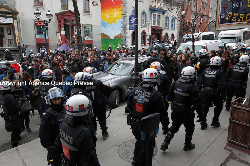 FILE PHOTO -  Montreal Police arrest anti-austerity demonstrators, April 9, 2015<br /> <br /> PHOTO : Pierre Roussel - Agence Quebec Presse