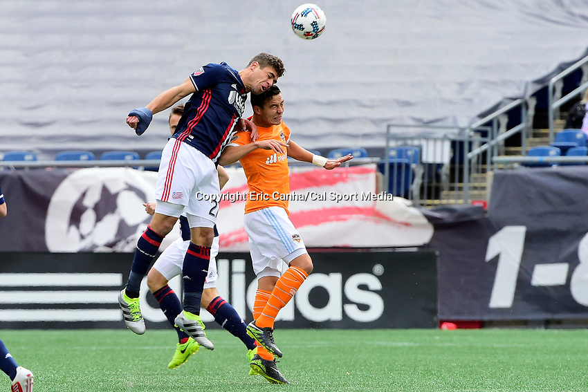 Saturday, April 8, 2017: New England Revolution defender Joshua Smith (27) heads the ball over Houston Dynamo forward Erick Torres (9) during the MLS game between Houston Dynamo and the New England Revolution held at Gillette Stadium in Foxborough Massachusetts. New England defeats Houston 2-0. Eric Canha/CSM