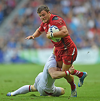 Wales's Luke Morgan is tackled by England's John Brake<br /> <br /> Wales Vs England - men's classification 5th - 6th place match<br /> <br /> Photographer Chris Vaughan/CameraSport<br /> <br /> 20th Commonwealth Games - Day 4 - Sunday 27th July 2014 - Rugby Sevens - Ibrox Stadium - Glasgow - UK<br /> <br /> © CameraSport - 43 Linden Ave. Countesthorpe. Leicester. England. LE8 5PG - Tel: +44 (0) 116 277 4147 - admin@camerasport.com - www.camerasport.com
