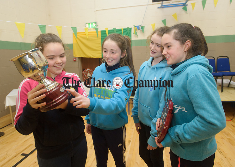 Emma Keane, Tierna Hegarty, Rachel Cotter and Muireann Daffy at the Inagh-Kilnamona Camogie Club's medal presentation ceremony for their Minor A U-21A and Kilmacud Sevens team victories. Photograph by John Kelly.