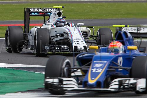 10.07.2016. Silverstone, England. Formula One British Grand Prix, race day.  Williams Martini Racing driver Valtteri Bottas chasing Sauber F1 Team driver Felipe Nasr.