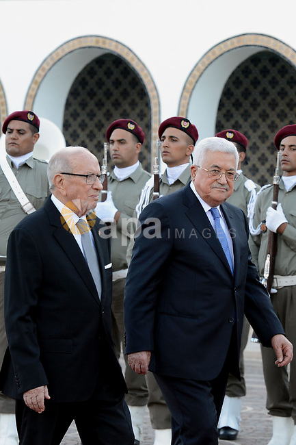 Tunisian President Beji Caid Essebsi reviews the honours guard with Palestinian President Mahmoud Abbas during a welcome ceremony at Carthage Palace, near Tunis, on July 6, 2017. Abbas is on 2 day official visit to Tunisia. Photo by Thaer Ganaim