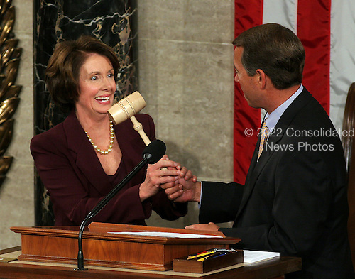 Washington, D.C. - January 4, 2007 --  United States Representative Nancy Pelosi (Democrat of the 8th District of California) accepts the gavel from U.S. Representative John Boehner (Republican of the 8th District of Ohio), the Minority Leader, after she was sworn-in as the Speaker of the United States House of Representatives in the Capitol in Washington, D.C. on Thursday, January 4, 2007.  Speaker Pelosi is the first woman in U.S. history to serve in that position..Credit: Ron Sachs / CNP