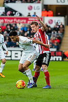 Neil Taylor of Swansea City  and Steven Davis of Southampton  in action during the Barclays Premier League match between Swansea City and Southampton  played at the Liberty Stadium, Swansea  on February 13th 2016
