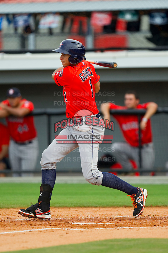 Edwin Gomez (1) of the Greeneville Astros follows through on his swing against the Burlington Royals at Burlington Athletic Park on July 1, 2013 in Burlington, North Carolina.  The Astros defeated the Royals 7-0 in Game One of a doubleheader.  (Brian Westerholt/Four Seam Images)
