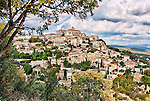 A view of the hill town of Gordes, located in the Luberon in Provence, France, from the road leading into the town.