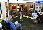 Artist and display at the Art in the Park festival in Keene, New Hampshire USA