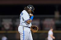 Surprise Saguaros third baseman Vladimir Guerrero Jr. (27), of the Toronto Blue Jays organization, kisses the ball before an inning during an Arizona Fall League game against the Scottsdale Scorpions at Scottsdale Stadium on October 15, 2018 in Scottsdale, Arizona. Surprise defeated Scottsdale 2-0. (Zachary Lucy/Four Seam Images)