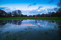 14/11/14<br /> <br /> Freya Kirkpatrick walks past flooded playing fields in Ashbourne, Derbyshire, ahead of a weekend of continued wet weather.<br /> <br /> All Rights Reserved - F Stop Press.  www.fstoppress.com. Tel: +44 (0)1335 300098