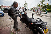 Photojournalist Pierre Alozie gets ready to ride to the next event in Islington. For Pierre Alozie's website please click here: http://www.magicmonkeys.net/ <br /> <br /> London, 07/06/2017. Documenting the last day of Jeremy Corbyn and the Labour Party electoral Campaign on the eve of the General Election 2017: Harrow.<br /> <br /> For a video of Jeremy Corbyn Speech please click here (Source, Jason N. Parkinson for Report digital, https://www.reportdigital.co.uk/): https://www.facebook.com/jason.n.parkinson/videos/10211031804124322/