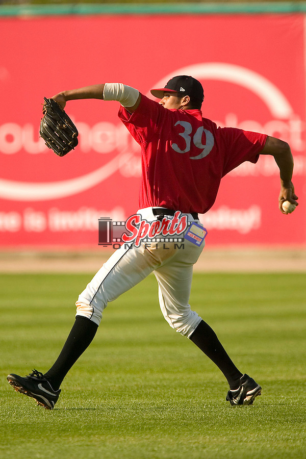 Kannapolis right fielder Salvador Sanchez makes a throw during fielding practice prior to taking on the Charleston River Dogs at Fieldcrest Cannon Stadium in Kannapolis, NC, Friday, April 28, 2006.