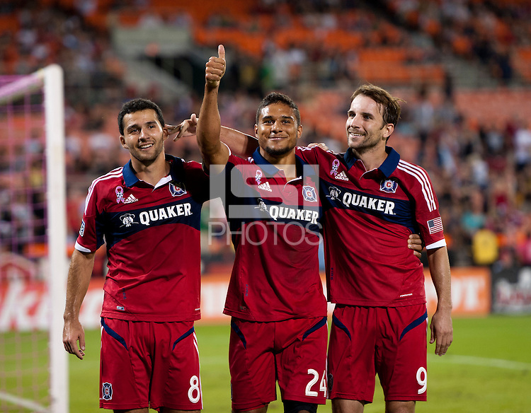 Quincy Amarikwa (24) of the Chicago Fire celebrates his goal with teammate Mike Magee (9) and Dilly Duka (8) during a Major League Soccer game at RFK Stadium in Washington, DC.  The Chicago Fire defeated D.C. United, 3-0.
