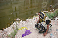 Mazeda Begum mourns at Rana Plaza site. Her daughter Erina Begum is still missing since the collapse happened on April 24, 2013, Savar, near Dhaka, Bnagladesh. Erina was working in one garment factory on 4th floor of Rana Plaza.