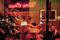 "Switzerland. Geneva. The Paquis neighborhood is known for its nightlife and Red-light district. Street prostitution. Most of the prostitutes work in the streets. Others wait inside and look through the windows for customers. Prostitution is often referred to as ""the world's oldest profession"". 18.03.12 © 2012 Didier Ruef"
