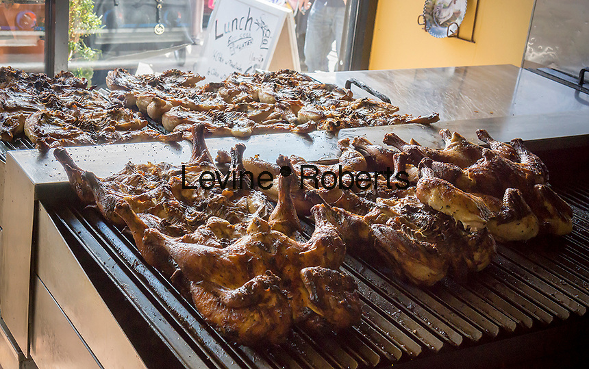 Chicken is grilled in a restaurant in the Jackson Heights neighborhood of Queens in New York on Friday, September 27, 2013.  Jackson Heights is a polyglot of ethnic groups ranging from Bangladeshis to South American to Indian to everyone else. (© Richard B. Levine)