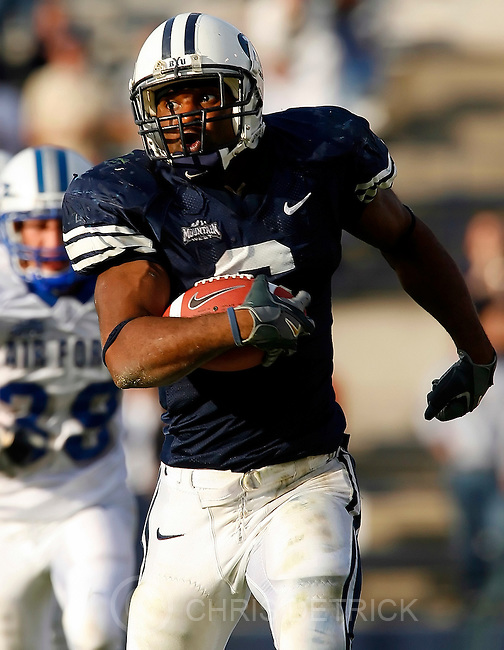 Salt Lake City, Utah --10/29/2005--4:40:13 PM.BUY's Curtis Brown rushes the ball during the fourth quarter of the game. Brown had 219 yards rushing and four touchdowns. .BYU won 62-41..BYU vs Air Force Football. ..Photo by: Chris DetrickThe Salt Lake Tribune.File #_J9A0757