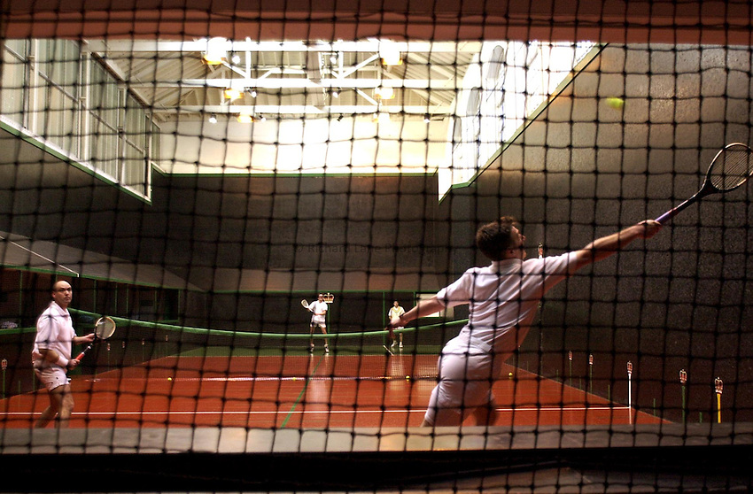 Photo:Ken Brown.16.1.2001Real tennis Professional Doubles Championship - Semi Final.Frank Filippelli gets a difficult shot back as he and Mike Gooding go on to win the match against Steve Virgona and Ruavaidh Gunn