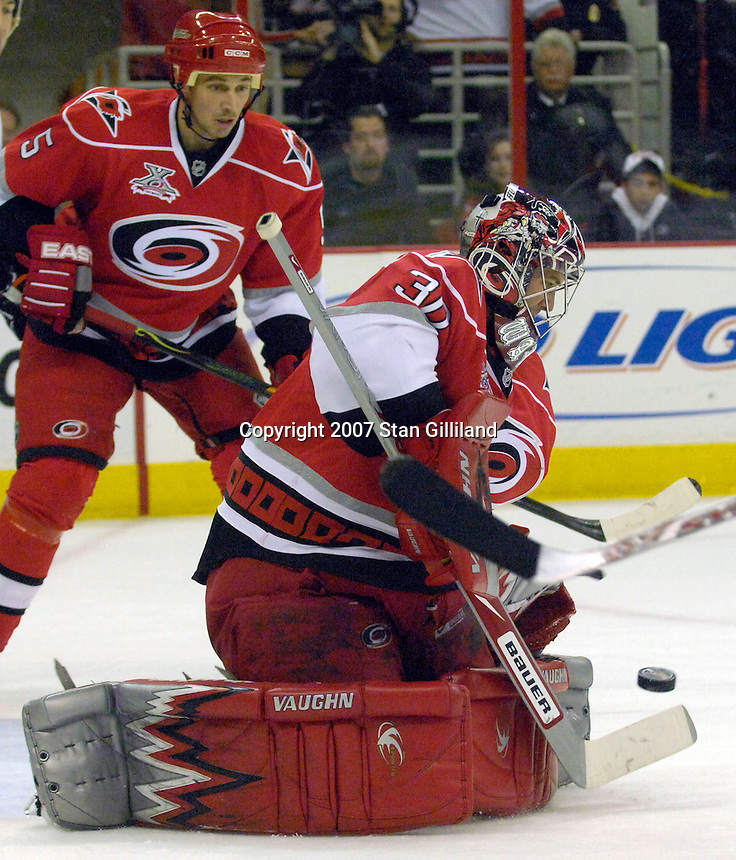 The Carolina Hurricanes' goalie Cam Ward makes a save against the Philadelphia Flyers during their game Wednesday, Nov. 21, 2007 in Raleigh, NC. The Flyers won 6-3.