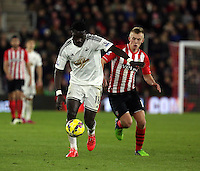 Pictured: Bafetimbi Gomis of Swansea followed by James Ward Prowse of Southampton Sunday 01 February 2015<br /> Re: Premier League Southampton v Swansea City FC at ST Mary's Ground, Southampton, UK.