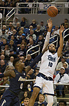 Nevada forward Caleb Martin (10) shoots over Akron's Jimond Ivey (0) in the first half of an NCAA college basketball game in Reno, Nev., Saturday, Dec. 22, 2018. (AP Photo/Tom R. Smedes)