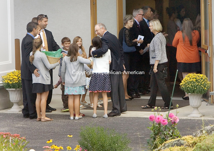HARWINTON CT. 15 September 2014-091514SV05-Family and friends enter the church for the funeral of former Rep. Joseph N. Ruwet at the Immaculate Heart of Mary Church in Harwinton Monday. <br /> Steven Valenti Republican-American