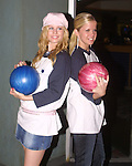 "Stephanie Gatschet (Tammy) and Crystal Hunt (Lizzie) at the ""Bloss and Friends"" bowling event hosted by Jerry verDorn (Ross) and Liz Kiefer at the Port Authority Bowling lanes to benefit the Cancer Foundation on October 9, 2004 (Photo by Sue Coflin)"