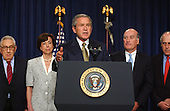 Washington, D.C. - June 23, 2005 -- United States President George W. Bush makes remarks on the Central American Free Trade Agreement (CAFTA).  Democratic and Republican officials from previous administrations stand with the President in support of the agreement. From left to right: former United States Secretary of State Henry Kissinger (Nixon and Ford); former United States Trade Representative Carla Hills (Bush 41); President Bush; former United States Secretary of Commerce William Daley (Clinton); and former Secretary of Agriculture Dan Glickman..Credit: Ron Sachs / CNP