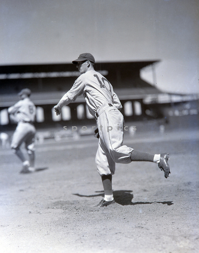 Philadelphia Athletics Left Grove (10) warming up from the 1930's.  Left Grove played for 17 years with 2 different teams, was a 6-time All-Star, 1931 MVP and was elected to the Baseball Hall of Fame in 1947.