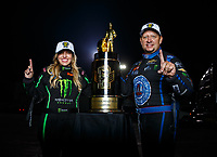 Nov 12, 2017; Pomona, CA, USA; NHRA funny car driver Robert Hight (right) poses for a portrait with top fuel teammate Brittany Force after both clinched the 2017 world championships in their classes during the Auto Club Finals at Auto Club Raceway at Pomona. Mandatory Credit: Mark J. Rebilas-USA TODAY Sports