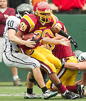 O'Dea running back Jomari Brooks (29) is taken down by Peninsula linebacker Michael George (40) at Memorial Stadium in Seattle, Washington, on Saturday, November 6, 2010. O'Dea won the game 21-7.