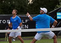 Netherlands, Den Bosch, 16.06.2014. Tennis, Topshelf Open, Jean-Julien Rojer (NED) with his doubles partner Horia Tecau (ROU)(R)<br /> Photo:Tennisimages/Henk Koster