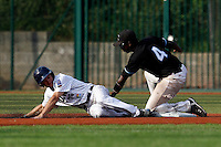 15 July 2011: Fred Hanvi of the Senart Templiers tags out Joris Bert at second base during the 2011 Challenge de France match won 6-5 by the Rouen Huskies over the Senart Templiers at Stade Pierre Rolland, in Rouen, France.