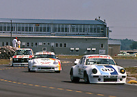 The #90 901 Shop Porsche 911 of M.H. Schaefer, Doug Zitza and  Jack Refenning leads the #11 Porsche 911 of Paul Goral, Larry Figaro and Peter Uria and the #91 BMW 2002 of C.W. Bryant, Alex Priest and Mike Guido at  the 12 Hours of Sebring endurance sports car race, March 19, 1983.  (Photo by Brian Cleary/www.bcpix.com)