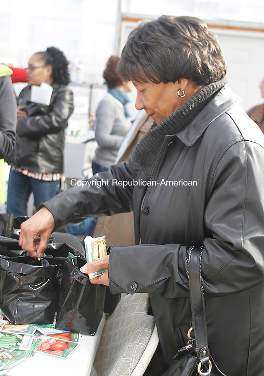 WATERBURY, CT-18 FEBRUARY 2012 021812JW03 - Thelma Parker of Waterbury starts planting her Golden Squash seeds during a gardening workshop conducted by Brass City Harvest Saturday morning..Jonathan Wilcox Republican American..