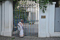 An Indian lady in front of a French building in the French colony in Pndicherry . Arindam Mukherjee