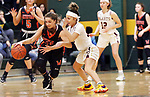 WATERBURY CT. 16 February 2018-021619SV23-#34 Chloe DeFeo of Watertown High tries to get past #0 Aamya Rivera of Sacred Heart High during the NVL girl&rsquo;s basketball tournament in Waterbury Saturday.<br /> Steven Valenti Republican-American