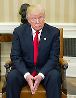 United States President-elect Donald Trump makes remarks to the media pool after meeting with US President Barack Obama in the Oval Office of the White House in Washington, DC on November 10, 2016.<br />