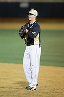 Wake Forest Demon Deacons first baseman Gavin Sheets (24) on defense against the Delaware Blue Hens at Wake Forest Baseball Park on February 13, 2015 in Winston-Salem, North Carolina.  The Demon Deacons defeated the Blue Hens 3-2.  (Brian Westerholt/Four Seam Images)