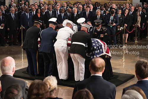 The flag-draped casket bearing the remains of John McCain of Arizona, who lived and worked in Congress over four decades, in carried into the U.S. Capitol rotunda for a farewell ceremony and public visitation, in Washington, Friday, Aug. 31, 2018. McCain was a six-term senator from Arizona, a former Republican nominee for president, and a Navy pilot who served in Vietnam where he endured five-and-a-half years as a prisoner of war. He died Aug. 25 from brain cancer at age 81.
