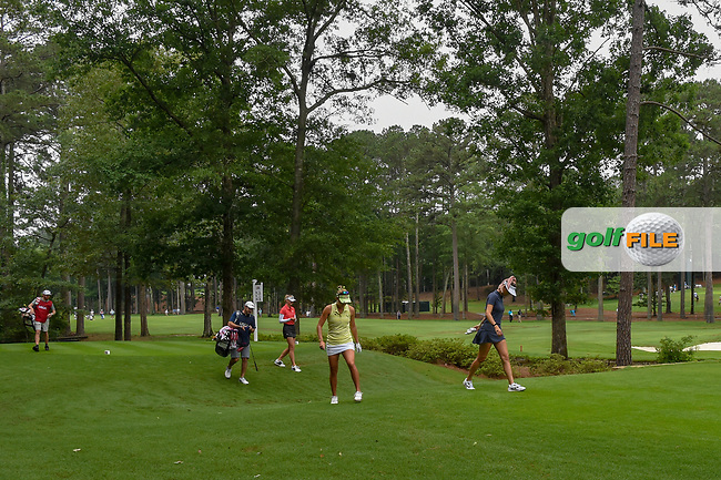 Lexi Thompson (USA), Michelle Wie (USA), and Jessica Korda (USA) walk through sloppy conditions as they head down 11 during round 1 of the U.S. Women's Open Championship, Shoal Creek Country Club, at Birmingham, Alabama, USA. 5/31/2018.<br /> Picture: Golffile | Ken Murray<br /> <br /> All photo usage must carry mandatory copyright credit (© Golffile | Ken Murray)
