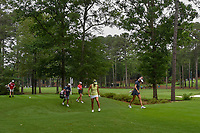 Lexi Thompson (USA), Michelle Wie (USA), and Jessica Korda (USA) walk through sloppy conditions as they head down 11 during round 1 of the U.S. Women's Open Championship, Shoal Creek Country Club, at Birmingham, Alabama, USA. 5/31/2018.<br /> Picture: Golffile | Ken Murray<br /> <br /> All photo usage must carry mandatory copyright credit (&copy; Golffile | Ken Murray)