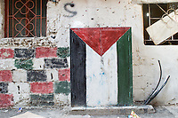 Palestinian flag painted on a wall of a  bulding in the Shatila camp. Beirut, Lebanon. August 2015