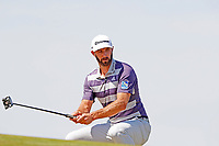 Dustin Johnson (USA) reacts to missing a putt on the first hole during the third round of the 118th U.S. Open Championship at Shinnecock Hills Golf Club in Southampton, NY, USA. 16th June 2018.<br /> Picture: Golffile | Brian Spurlock<br /> <br /> <br /> All photo usage must carry mandatory copyright credit (&copy; Golffile | Brian Spurlock)