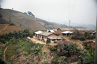 A small village stands on top of a hill in the mountains around Xinjie, Yunnan Province, China.