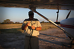 Colin, a seasoned pilot from Alaska ties his Cessna 207 light aircraft down on the edge of the Makadikadi pans. There are no visible lights on the runways on most landing strips in Botswana.
