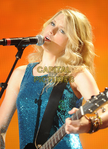 TAYLOR SWIFT.2008 CMA Music Festival Nightly Concert held at LP Field, Nashville, Tennessee, USA..June 5th, 2008.stage concert live gig performance music half length blue sequins sequined  dress guitar singing .CAP/ADM/MS.©Mike Strasinger/AdMedia/Capital Pictures.