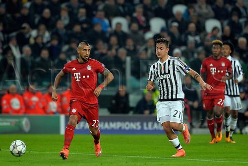23.02.2016. Turin, Italy. UEFA Champions League football. Juventus versus Bayern Munich.  Arturo Vidal shields the ball from Paulo Dybala